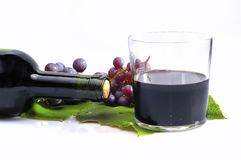Isolated  grapes. Grapes with a glass of wine alone Royalty Free Stock Photography