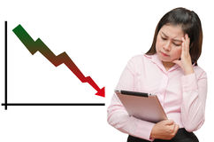 Isolated graph continues going down and business woman see table Royalty Free Stock Photography