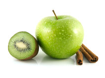 Isolated green apple and kiwi with cinnamon pods. Isolated wet green apple and kiwi with cinnamon pods (white background). Fresh diet fruit (water drops) Stock Photos