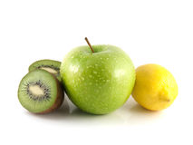 Isolated green apple, kiwi and yellow lemon. (white background). Fresh diet fruit (water drops). Healthy fruit with vitamins Royalty Free Stock Photography