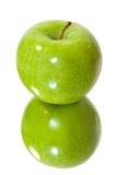 Isolated green apple in mirror Royalty Free Stock Photography