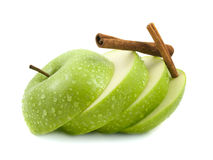 Isolated green apple slices with cinnamon pods. (white background). Fresh diet fruit (water drops). Healthy fruit with vitamins Royalty Free Stock Photo