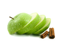 Isolated green apple slices with cinnamon pods. (white background). Fresh diet fruit (water drops). Healthy fruit with vitamins Stock Photos