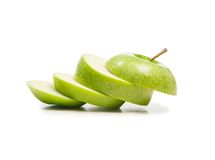 Isolated green apple slices isolated over white Royalty Free Stock Photography