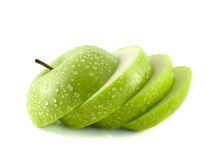 Isolated green apple slices with water drops Stock Image