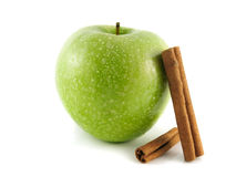 Isolated green apple with water drops and cinnamon Royalty Free Stock Image