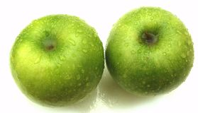Isolated green apples in the water drops Stock Images
