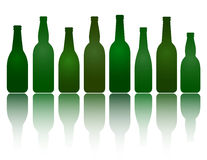 Isolated green beer bottles Royalty Free Stock Photos