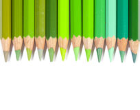 Isolated green color pencils in line Royalty Free Stock Photos
