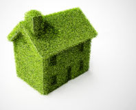 Isolated Green eco home. Environmental eco home on white background Royalty Free Stock Images