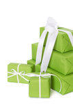 Isolated green giftboxes tied with white ribbon Royalty Free Stock Images