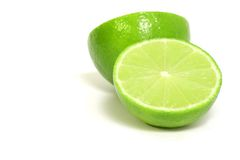 Isolated green limes on white background Royalty Free Stock Images