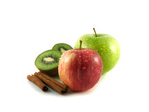 Isolated green and red apples, kiwi with cinnamon. Isolated wet green and red apples and kiwi with cinnamon pods (white background). Fresh diet fruit (water Stock Image