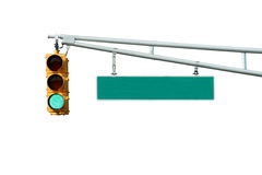 Isolated Green traffic signal light with sign Royalty Free Stock Images