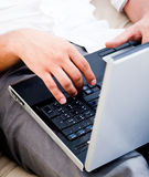 Isolated grey open laptop man typing. Closeup of open laptop man typing royalty free stock photos
