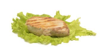 Isolated grilled meat on the leaf of salad Stock Photo