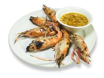 Isolated Grilled Prawns. Grill prawns over hot charcoal served with chilli and garlic sauce, saved with clipping path Stock Images