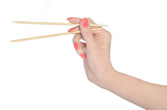 Isolated gripping chopsticks Royalty Free Stock Photo
