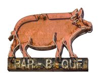 Rustic Barbecue Diner Sign. Isolated Grungy Rustic Old Neon Pig Sign For A Bar-B-Que Barbecue Diner royalty free stock image