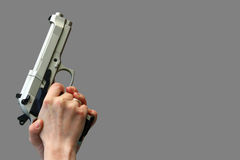 Isolated gun in hand Royalty Free Stock Photos