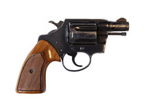 Isolated Gun. Old antique black hand gun with wooden handle Royalty Free Stock Photo
