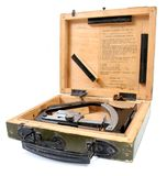 Isolated gunner's clinometer. Isolated packed gunner's clinometer with wooden box and with certificate made in USSR in 1949 Royalty Free Stock Image
