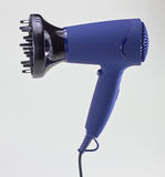 Isolated hair dryer on gray Royalty Free Stock Images
