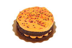 Isolated halloween orange chocolate cake Stock Photo