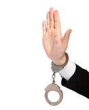 Isolated hand of a businessman in a handcuffs shows a stop Stock Image