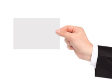 Isolated hand of a businessman holding a piece of paper Stock Photo