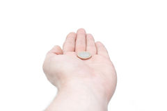 Isolated hand with coin. Selective focus Stock Images