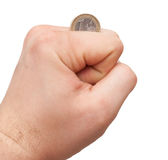 Isolated hand with coin. Selective focus Stock Photos
