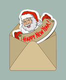 Isolated hand-drawn colored kraft envelope and sticker with cartoon Santa Claus. Vector illustration Stock Photo