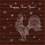 Isolated hand drawn decorated rooster on wood Stock Image