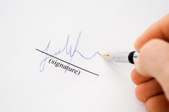 Isolated hand with fountain pen signing paper royalty free stock photos