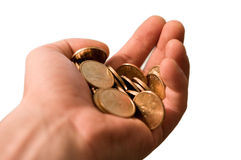 Isolated hand with gold coins. Hand full of cion isolated on white Royalty Free Stock Photo