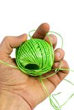 Hand and green fiber Royalty Free Stock Photos