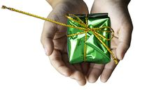 Isolated Hand holding Gift box green for the festivities on a white background. Isolated Hand holding Gift box green for the festivities on a white background stock photos
