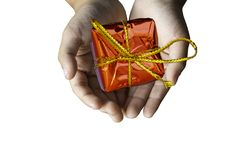 Isolated Hand holding Gift box red for the festivities on a whit. E background , Thailand royalty free stock photography