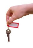 Isolated hand holding and passing keys on white background Royalty Free Stock Images