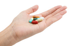 Isolated of Hand holding a pill capsule Stock Image