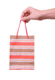 Isolated hand holding shopping paper bag Stock Photo