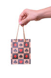 Isolated hand holding shopping paper bag. On white Stock Photos