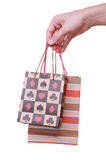 Isolated hand holding shopping paper bag. On white Stock Images