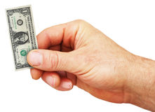 Isolated hand holding tiny dollar bill Stock Image
