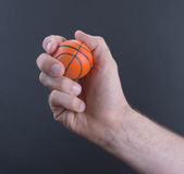Isolated hand with a mini basket ball Stock Photos