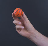 Isolated hand with a mini basket ball Royalty Free Stock Photos