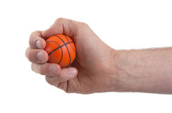 Isolated hand with a mini basket ball Royalty Free Stock Image