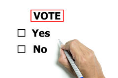 Isolated hand and pen to vote yes or no Royalty Free Stock Photo