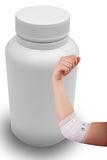Isolated hand of woman, injured painful elbow with white bandage and medicine bottle Royalty Free Stock Image
